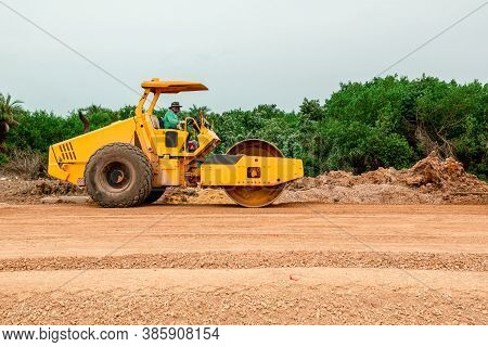 Vibratory Soil Compactor Working On Highway Construction Site. Tandem Vibration Roller Compactor Wor