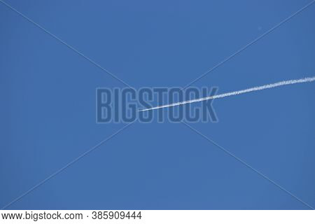 Contrails Of An Airplane In The Blue Sky Over Liechtenstein