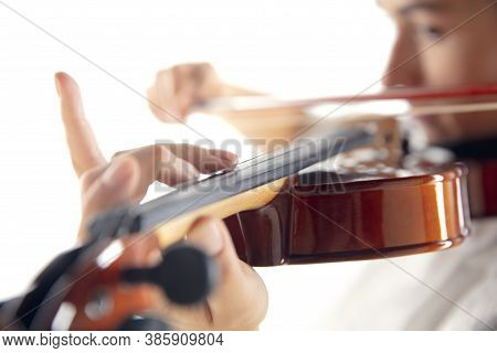 Close Up Woman Playing Violin Isolated On White Studio Background. Inspired Musician, Details Of Art