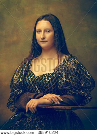 Beautiful. Young Woman As Mona Lisa, La Gioconda Isolated On Dark Green Background. Retro Style, Com