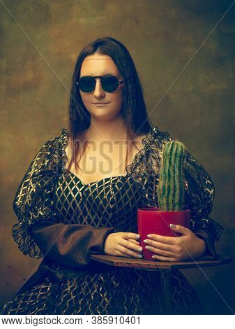 Cactus Friend. Young Woman As Mona Lisa, La Gioconda Isolated On Dark Green Background. Retro Style,