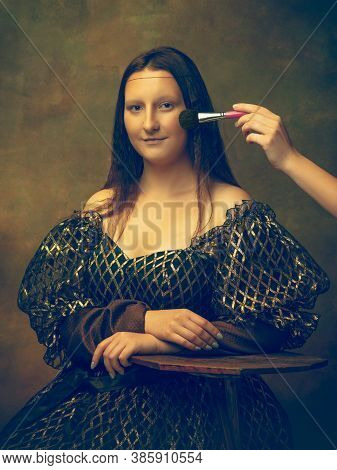 Make Up. Young Woman As Mona Lisa, La Gioconda Isolated On Dark Green Background. Retro Style, Compa