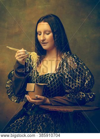 Instant Noodles. Young Woman As Mona Lisa, La Gioconda Isolated On Dark Green Background. Retro Styl