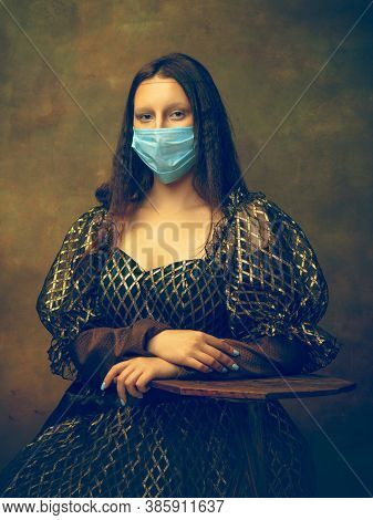 Face Mask. Young Woman As Mona Lisa, La Gioconda Isolated On Dark Green Background. Retro Style, Com