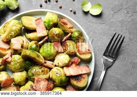 Delicious Fried Brussels Sprouts With Bacon Served On Grey Table, Flat Lay