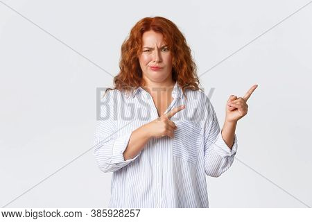 Skeptical And Displeased, Complaining Redhead Middle-aged Woman Smirk Unsatisfied, Pointing Fingers