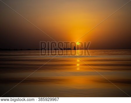 Beautiful Scenic Landscape. Golden Sunset On The Sea. Full Calm, Calm Surface Of Water In The Ocean