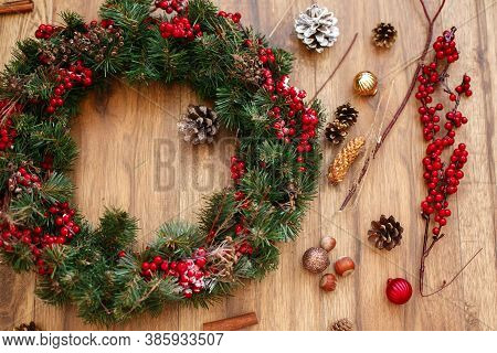 Christmas Wreath On Wooden Rustic Background Flat Lay.