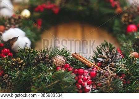Christmas Wreath Decorations Close Up On Wooden Rustic Background.
