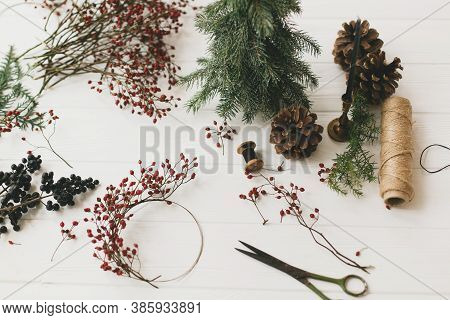 Details For Rustic Christmas Wreath On White Wooden Table.