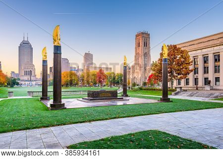 Indianapolis, Indiana, USA monuments and downtown skyline at dusk.