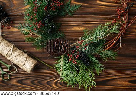 Rustic Christmas Wreath On Wooden Table Flat Lay, Holiday Workshop.