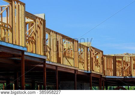 Wood Building Frame Structure On A New Development Framing Of New House Under Construction