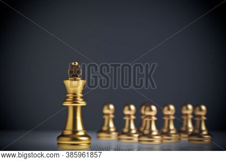 The Golden King Of Chess Stands Out From The Hordes Of Pawns Behind It. Concept Of Leadership And Su