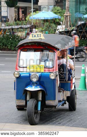 Bangkok, Thailand Feb 1, 2018: Tuk Tuk Is A Three-wheeled Motorized Vehicle Used As A Taxi With Pass