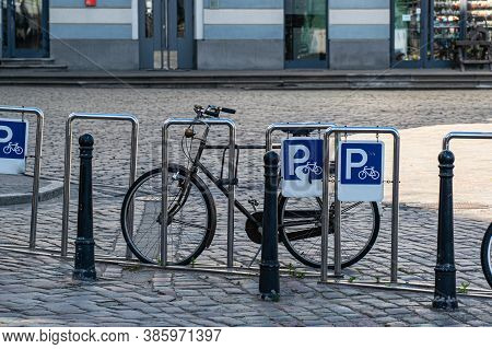 The Vintage Bike Is Parked In A Dedicated Parking Lot. Bicycle Parking In The City.