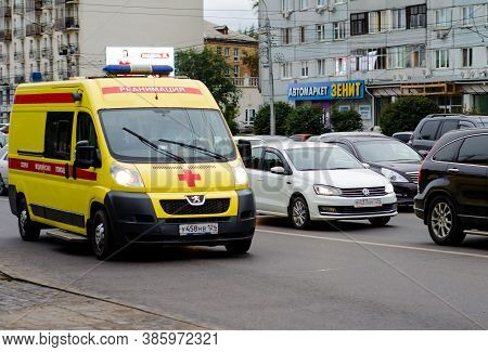 Ambulance In A Traffic Jam On A City Street. Movement. Emergency Medical Care. The Resuscitation Mac