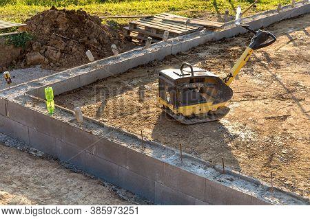 Vibratory Plate Compactor Under Construction. Vibratory Plate Compactor In Construction Site. Constr