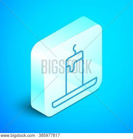 Isometric Line Burning Candle Icon Isolated On Blue Background. Cylindrical Candle Stick With Burnin