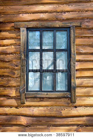 Vintage window on wooden wall