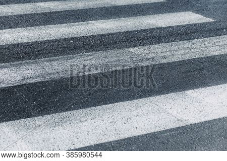 Empty Crosswalk In Gray And White. Pedestrian Crossing, Asphalt Road. Zebra Crossing At The Intersec