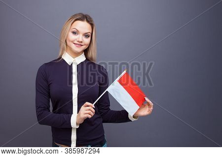 Immigration And The Study Of Foreign Languages, Concept. A Young Smiling Woman With A Monaco Flag In