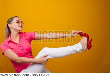 Uncomfortable Fashion Shoes, Glamorous Shoes Calluses And Squeeze The Foot. Woman Takes Off Her Stil