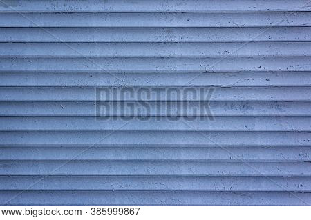 Background Of Blue Horizontal Metal Strips With Peeling Paint. Roller Blinds And Garage Gates. Close