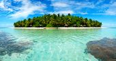 Beautiful Maldivian atoll with white beach seen from the sea.Panorama poster