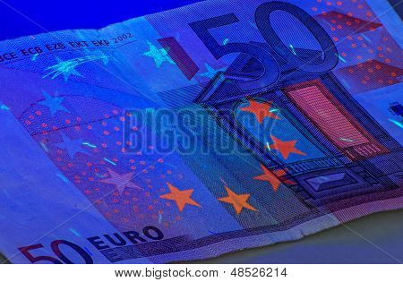 a Fifty Euro bill under ultraviolet light