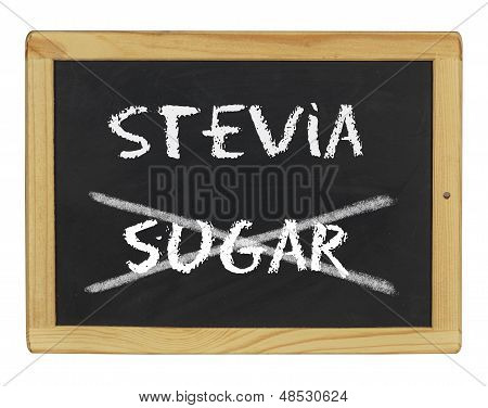 chalkboard with stevia and sugar written on it