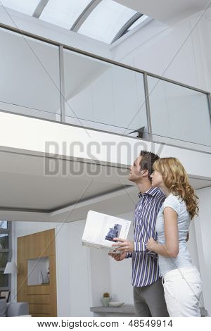 Low angle view of a young couple observing new home