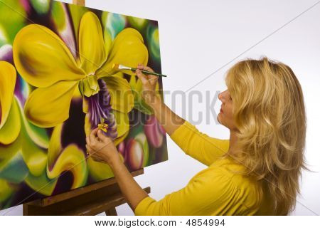 A Female Artist Painting On Canvas In Her Studio