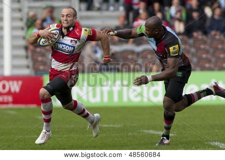 17/09/2011. Twickenham, England.  Gloucester's Charlie Sharples,  and Harlequins Ugo Monye, in action during the Aviva premiership rugby union match between Harlequins and Gloucester