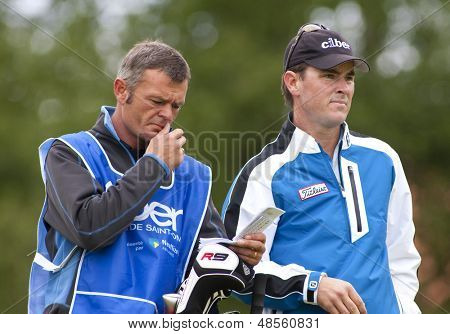 SAINT-OMER, FRANCE. 19-06-2010, Matthew Zions (AUS) and caddy at the European Tour, 14th Open de Saint-Omer, part of the Race to Dubai tournament and played at the AA Saint-Omer Golf Club .