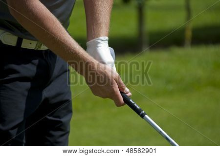 SAINT-OMER, FRANCE. 16-06-2010, A golfer grips a club on the preview day of the European Tour, 14th Open de Saint-Omer, part of the Race to Dubai tournament and played at the AA Saint-Omer Golf Club .