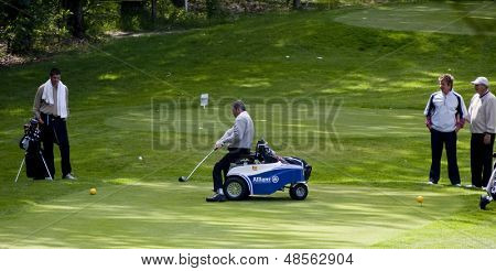 SAINT-OMER, FRANCE. 16-06-2010, A disabled golfer using a special golf buggyatthe European Tour, 14th Open de Saint-Omer, part of the Race to Dubai tournament and played at the AA Saint-Omer Golf Club