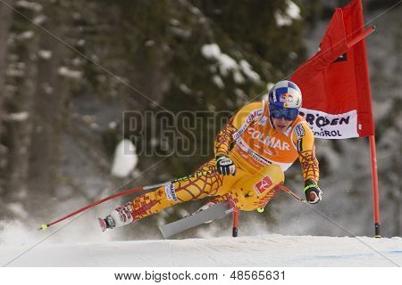 VAL GARDENA, ITALY 19 December 2009. Erik Guay (CAN) takes to the air whilst attacking the Ciaslat bend, while competing in the Audi FIS Alpine Skiing World Cup Downhill race on the Saslong course
