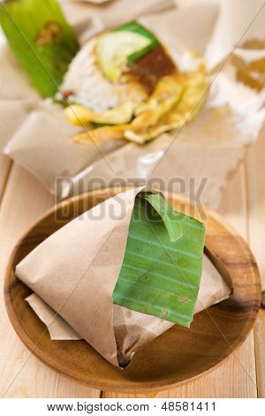 Nasi lemak - traditional Malaysian breakfast on banana leaf