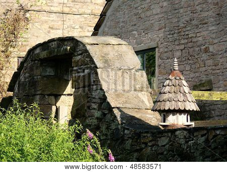 Bird house and stone arch