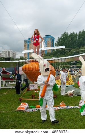 MOSCOW - JULY 28: Participants posing before fly on Red Bull Flugtag on July 28, 2013 in Moscow. Red Bull Flugtag is an event in which competitors attempt to fly homemade human-powered flying machines