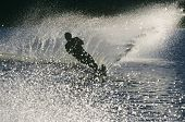 Full length of a silhouette male water skier in action poster