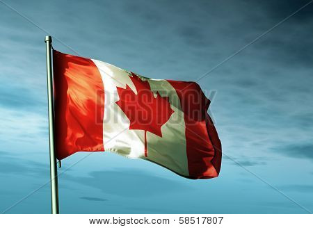 Canadian flag waving in the evening