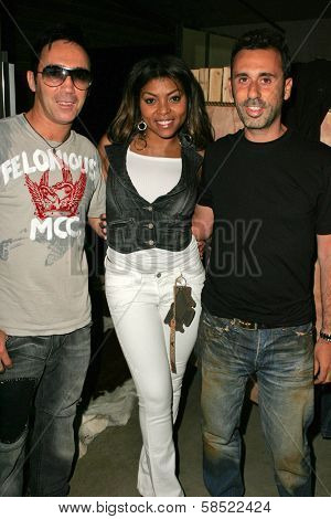 WEST HOLLYWOOD - AUGUST 24: Philippe Naouri with Taraji P. Henson and Alexandre Caugant at the Antik Denim Pre-Emmy Gift Experience on August 4, 2006 at Antik Denim in West Hollywood, CA.