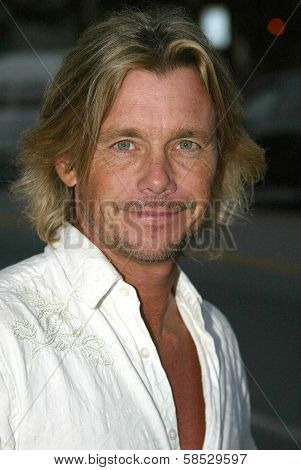 LOS ANGELES - AUGUST 15: Christopher Atkins at the Christian Audigier New Collection Launch Party in Babe Le Strange on Melrose on August 15, 2006 in Los Angeles, CA.