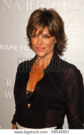 BEVERLY HILLS - APRIL 26: Lisa Rinna at the Nina Ricci Fashion Show and Gala Dinner to Benefit The Rape Foundation Barneys New York at Barneys New York on April 26, 2006 in Beverly Hills, CA.