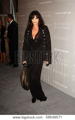 BEVERLY HILLS - APRIL 26: Michelle Johnson at the Nina Ricci Fashion Show and Gala Dinner to Benefit The Rape Foundation at Barneys New York on April 26, 2006 in Beverly Hills, CA.
