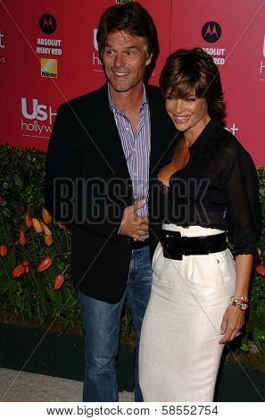 HOLLYWOOD - APRIL 26: Harry Hamlin and Lisa Rinna at the US Weekly Hot Hollywood Awards at Republic Restaurant and Lounge on April 26, 2006 in West Hollywood, CA.