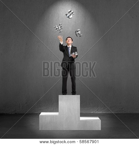 Businessman Standing On Podium Throwing And Catching 3D Money Symbols
