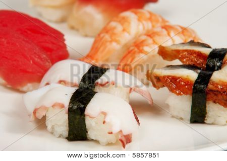 Set of seven sushi on grey mirror table poster
